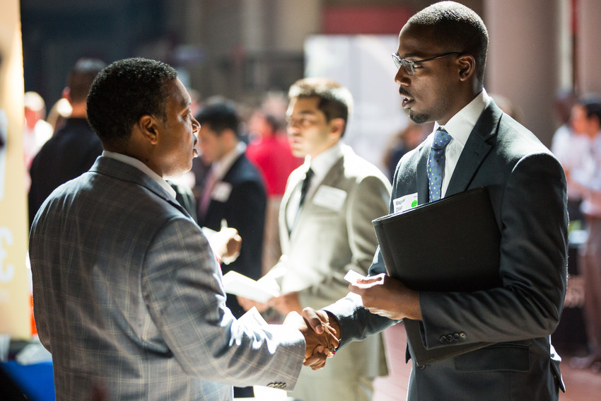 career fair photo student shaking hands with employer